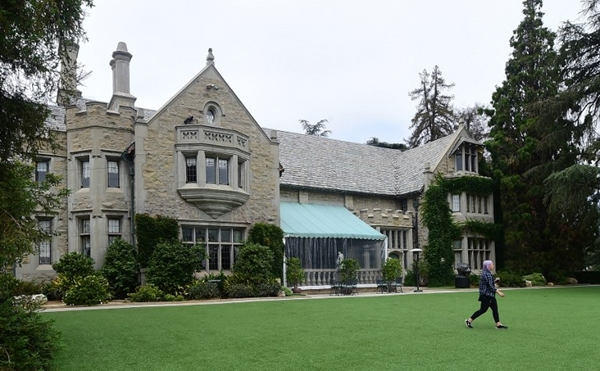 "(FILES) This file photo taken on May 11, 2016 shows the Playboy Mansion in Holmby Hills, Los Angeles, California. The Playboy Mansion, the legendary party house where Hollywood's eilte cavorted with scantily-clad ""bunnies,"" is being sold to the billionaire Twinkies owner who lives next door, a spokesman said June 6, 2016. Hugh Hefner, the 90-year-old owner of the Holmby Hills estate in southern California and founder of the iconic Playboy Magazine, will be permitted to continue living there for the rest of his life. The buyer is Daren Metropoulos, a 32-year-old business tycoon who lives on the property next door to the mansion, which he bought from Hefner in 2009 for $18 million.   / AFP PHOTO / FREDERIC J. BROWN"