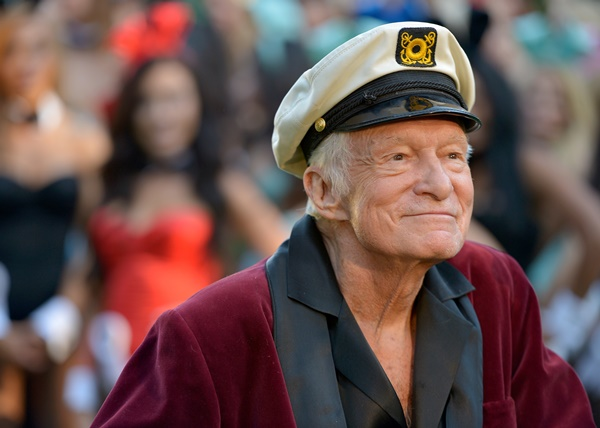 (FILES) This file photo taken on January 15, 2014 shows Hugh Hefner posing during Playboy's 60th Anniversary special event in Los Angeles, California.   Hugh Hefner, the silk pajamas-wearing founder of Playboy Magazine who helped steer nudity into the American mainstream died Wednesday, September 27, 2017 his magazine announced on Twitter. He was 91 years old. / AFP PHOTO / GETTY IMAGES NORTH AMERICA / Charley Gallay