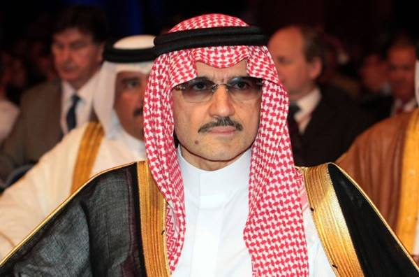 Saudi Arabia's Prince Al-Walid bin Talal attends the opening session of the 12th Doha Forum and Enriching the Middle East's Economic Future Conference in Doha, on May 20,2012. AFP PHOTO/STR / AFP PHOTO / -